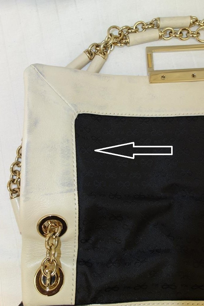 Anya Hindmarch handbag with ink staining on inside flap 2